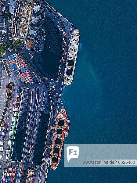 Russia  Primorsky Krai  Vladivostok  Aerial view of industrial ships moored in coal loading dock