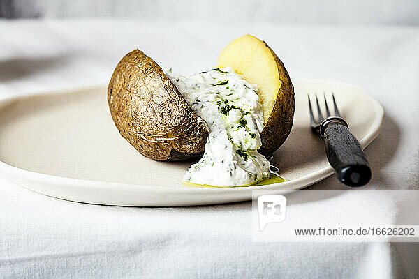 Baked potato with herb quark and homemade ramsonoil