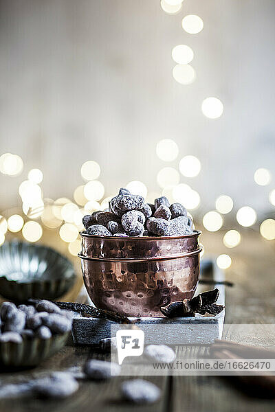 Bowl of homemade roasted almonds with chocolate and gingerbread spice