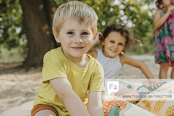 Smiling kids spending leisure time at beach