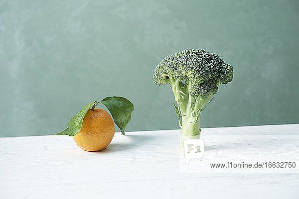 An orange and broccoli