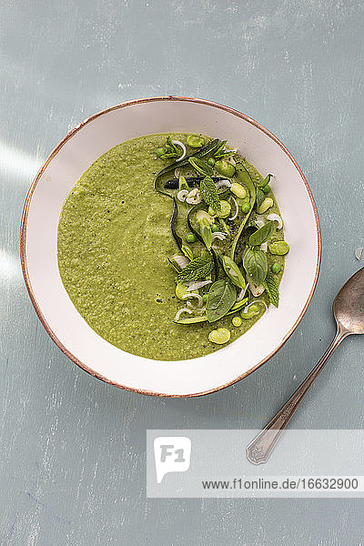 Green legume soup with peas and beans