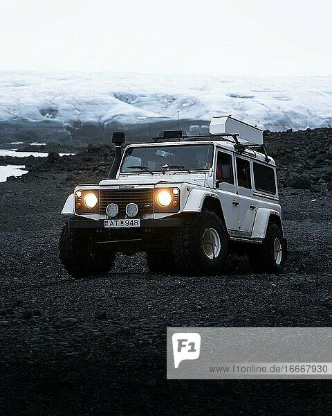 White Land Rover in front of a glacier  Vatnajökull glacier  Iceland  Europe