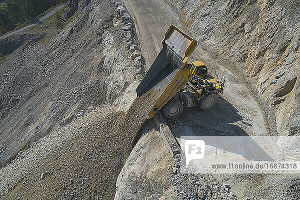 Mining Dumper unloading from aerial view