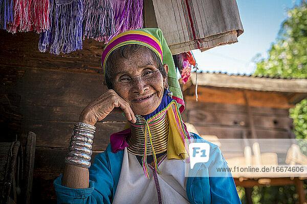 Portrait of smiling senior Burmese woman from Kayan tribe  Mya