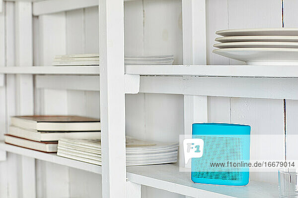 White shelf with wireless speaker