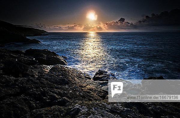 Setting Sun  Overlooking Rocks And Headland