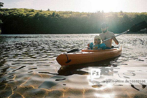 A family enjoying a sunny summer day at the lake.