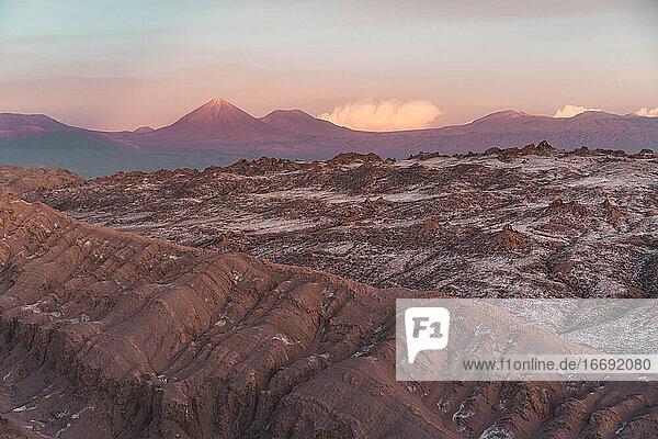 Desert Ridgeline in Atacama with scenic volcanos in the background