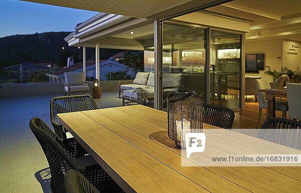 Lantern with candle on luxury home showcase patio dining table