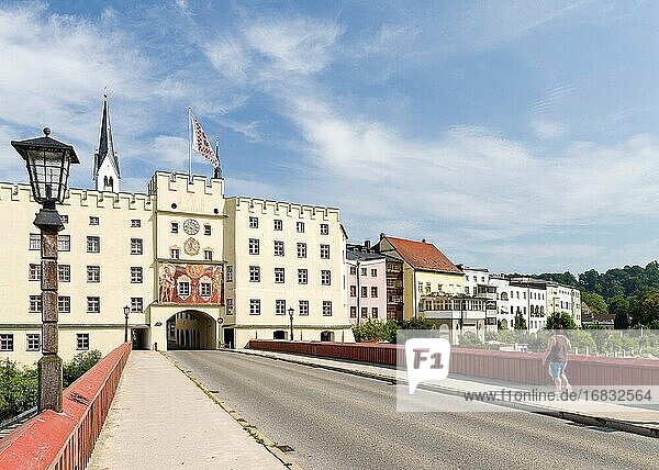 The Rote Bruecke (red bridge) crossing river Inn and the town gate Brucktor. The medieval old town of Wasserburg am Inn in the Chiemgau region of Upper Bavaria  Europe  Germany  Bavaria.