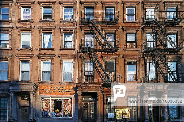 Fire escapes on tenement apartment buildings in Harlem neighborhood  New York City.