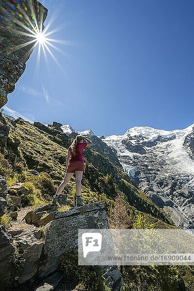 Hiker looking at glacier Glacier de Taconnaz  view from the hike La Jonction  Chamonix  Haute-Savoie  France  Europe