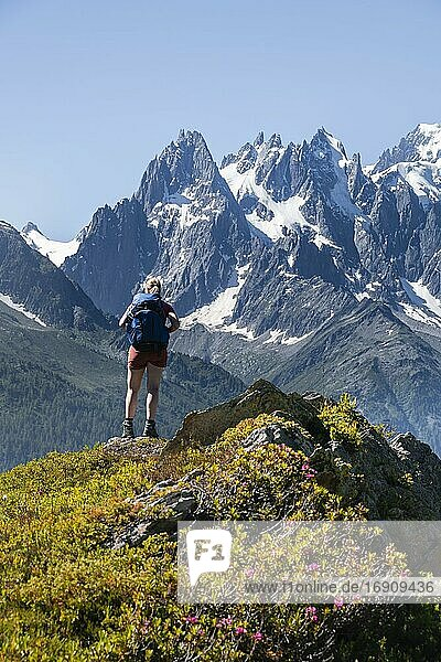 Hiker looking at mountain panorama from Aiguillette des Posettes  Aiguille du Midi  Chamonix  Haute-Savoie  France  Europe