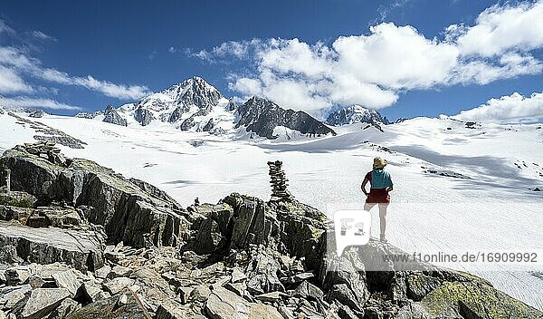 Hiker standing in front of glacier  Glacier du Tour  glacier and mountain peak  high alpine landscape  left Aiguille du Chardonnet  Chamonix  Haute-Savoie  France  Europe