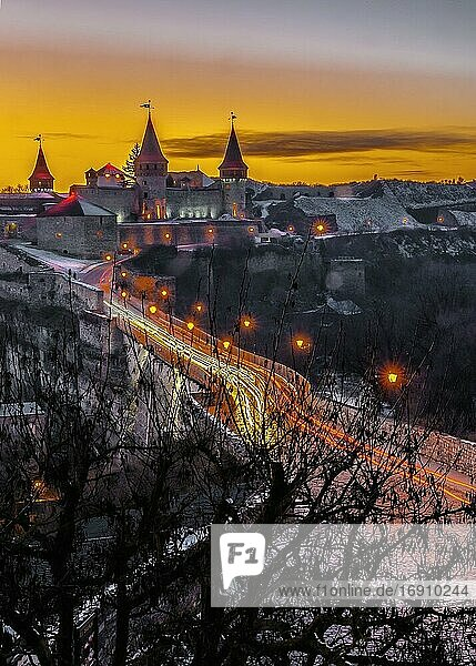 Kamianets-Podilskyi  Ukraine 01. 07. 2020. Panoramic view of the Kamianets-Podilskyi fortress on a winter night.
