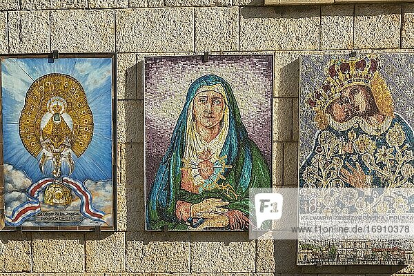Stone wall with mosaics of religious scenes  The Church of the Annunciation  Nazareth  Israel.