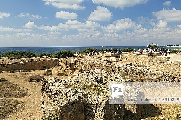 Ancient ruins and tourists at Tombs of the Kings archaeological site  UNESCO World Heritage site  Pafos  Cyprus.