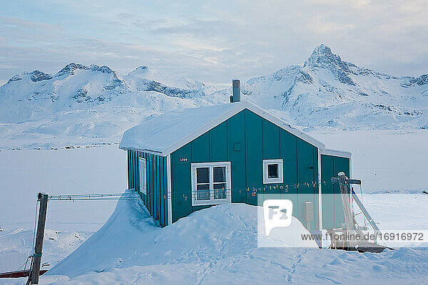 House in winter covered in snow  Tasiilaq  south eastern Greenland