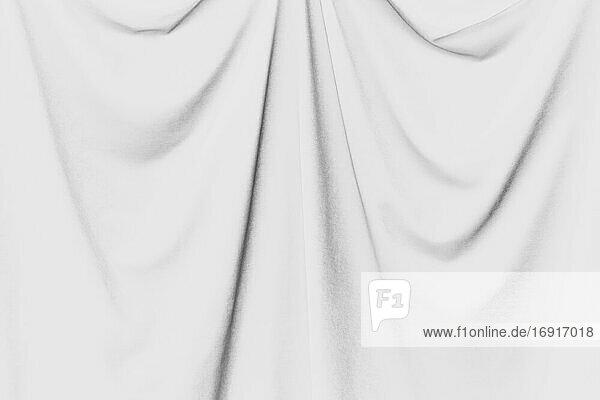 Inverted black and white image of draped velvet curtain