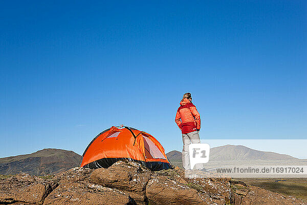 Woman standing by tent  Iceland