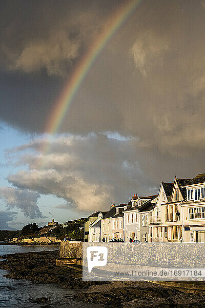 Cloudy sky with rainbow over Saint Mawes  Cornwall  UK.