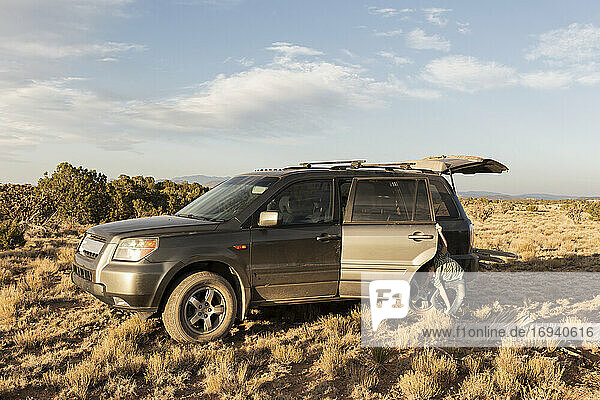 young boy with SUV  Galisteo Basin