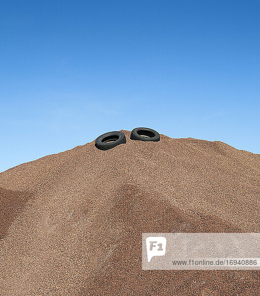 Heap of gravel with rubber tires  blue sky
