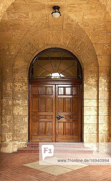 Wooden door in stone arch.