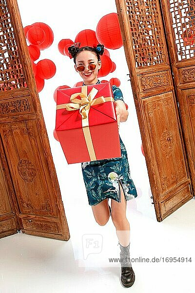Happy woman with a New Year gift