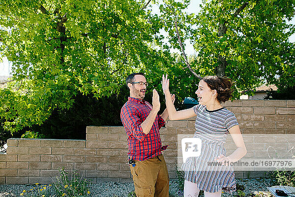 Teen Girl Jumps To Give Her Dad A High Five