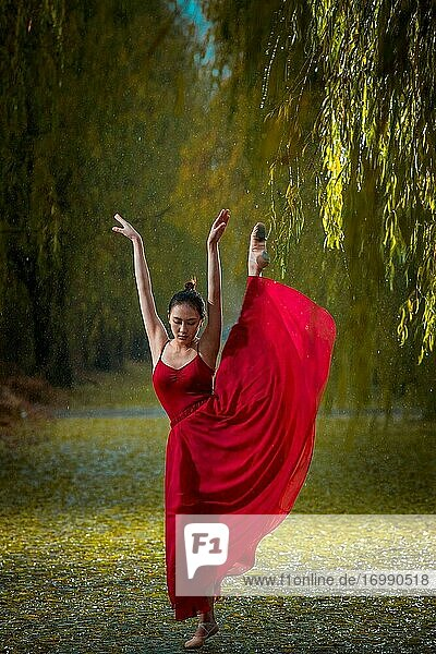 The young woman in the red skirt in the outdoor dance ballet