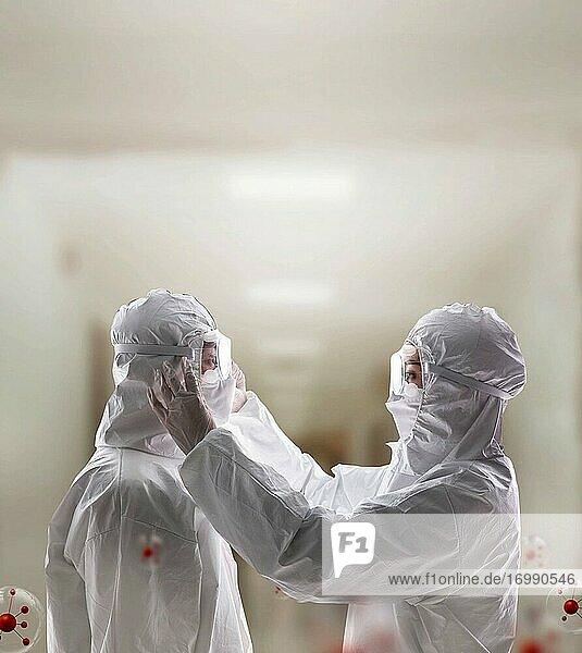 Die Ärzte helfen sich gegenseitig  Schutzkleidung zu tragen