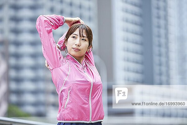 Young Japanese woman training downtown Tokyo