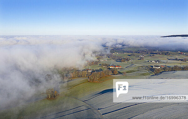 Drone view of countryside shrouded in thick fog