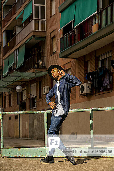 Young man moving and dancing outdoors