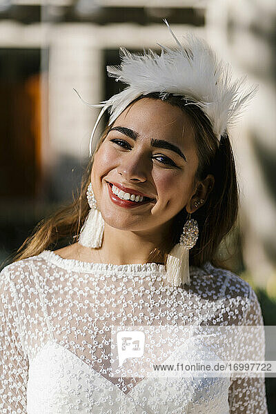 Smiling attractive bride on sunny day