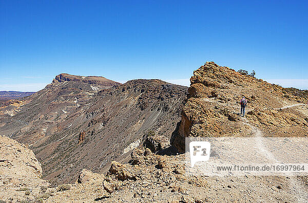 Male hiker on way to Sombrero De Chasna during sunny day  Teide National Park  Tenerife  Canary Islands  Spain