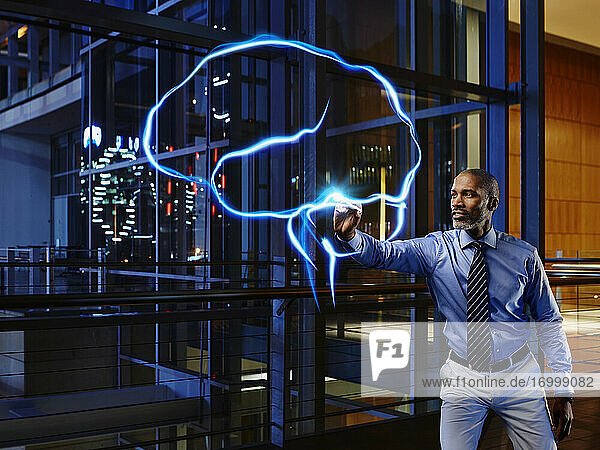 Male specialist light painting brain in laboratory at hospital