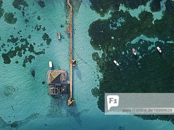 Pier on turquoise sea  aerial view  Huraa Island  Maldives