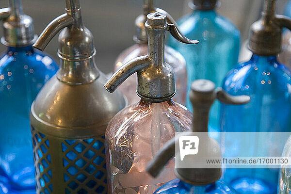 Antique soda bottles at flea market
