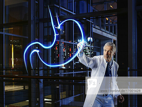 Male gastroenterologist light painting esophagus in laboratory at hospital