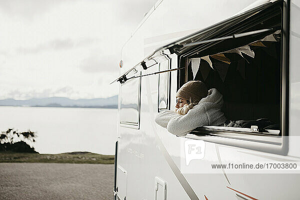 UK  Scotland  Highland  young woman at the window of a camper van