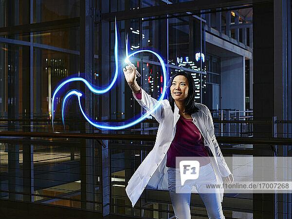 Female gastroenterologist light painting esophagus in laboratory at hospital