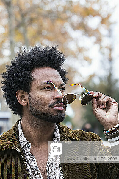 Close-up of stylish man with afro hair wearing sunglasses
