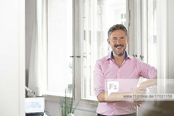 Happy male entrepreneur in office