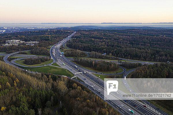 Germany  Baden-Wurttemberg  Stuttgart  Aerial view of traffic on Bundesautobahn 8 at dusk