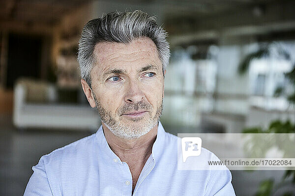 Male entrepreneur with blue eyes looking away