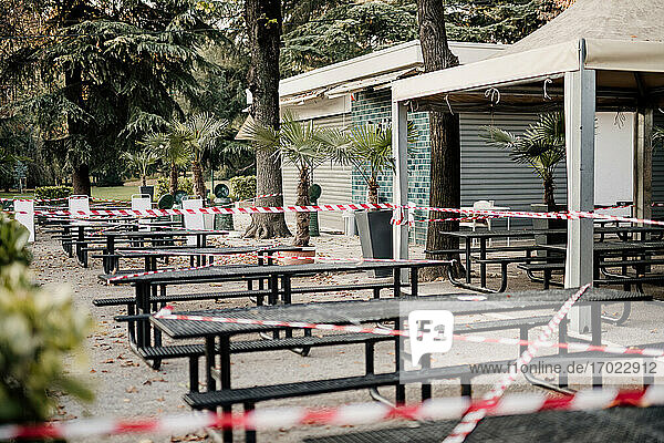 Cordon tape around seating outside cafe during 2020 Covid-19 Lockdown  Milan  Italy