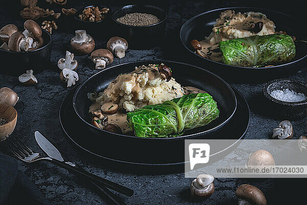 Vegetarian savoy cabbage roulade with a mushroom and quinoa filling